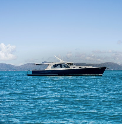 qualia Resort luxury experience activity with sailing boat on the water in Whitsundays