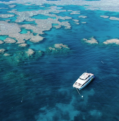 Aerial view of boat in Great Barrier Reef during qualia resort experience of diving and snorkelling