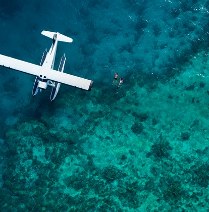 qualia aerial view of luxury sea plane landed from scenic flight on a Great Barrier Reef tour