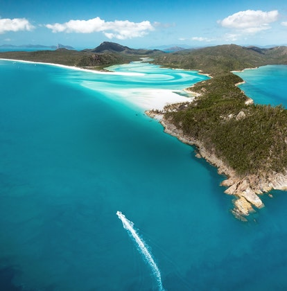 qualia aerial view of boats surrounding Whitehaven Beach and Whitsunday Island