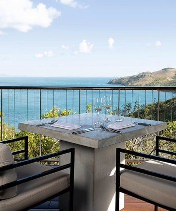 qualia resort golf clubhouse lunch table set up on balcony with Whitsundays views