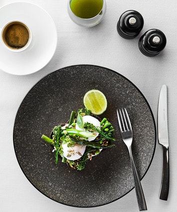 qualia resort breakfast table setting at Long Pavilion restaurant with poached eggs and coffee