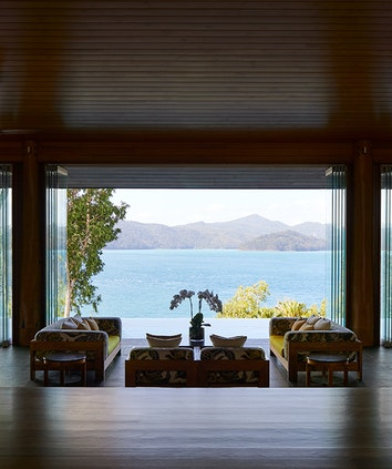 Entrance to qualia resort Long Pavilion restaurant with lounge area and Whitsundays views