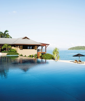 qualia resort Pebble Beach infinity pool with restaurant overlooking beach and Whitsundays views