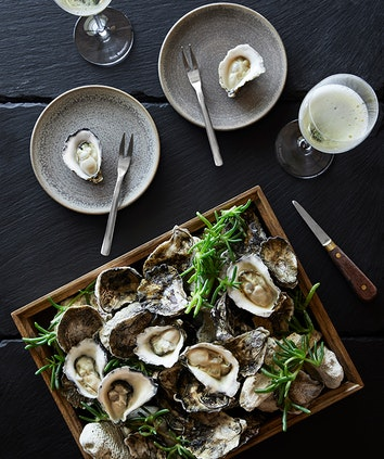 Platter of oysters and glass of champage as part of Talk and Taste experience at qualia resort's Long Pavilion