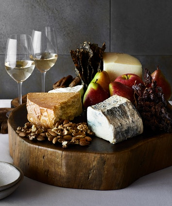 Platter of cheese and accompaniments as part of Talk and Taste Wine and Cheese experience at qualia Long Pavilion restaurant
