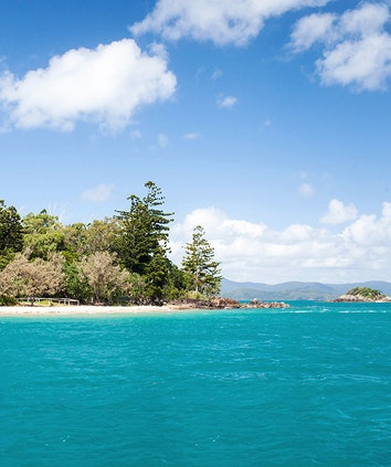 Beach and turquoise Whitsundays waters as part of qualia resort experience of Beach Drop Off