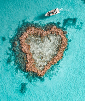 Aerial view of Hamilton Island Heart Pontoon and Heart Island in Heart Reef in the Great Barrier Reef