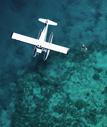 Aerial of luxury sea plane landed on Great Barrier Reef waters as part of qualia scenic flight experience