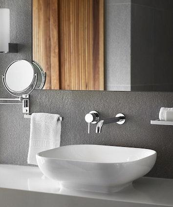 Bathroom sink, chrome tapware and mirror at qualia resort's Leeward Pavilion Bathroom