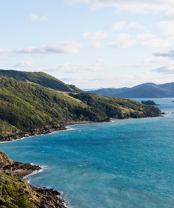 Aerial view of stunning blue water and Hamilton Island Golf Club