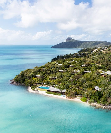 Aerial view of qualia resort including pavilions, restaurant, swimming pool and Whitsunday waters