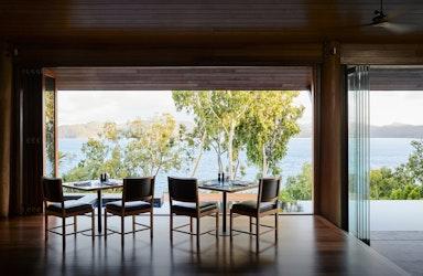 Whitsundays views of breakfast tables set at qualia resort's Long Pavilion restaurant