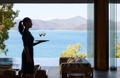 qualia waiter carrying tray of champagne glasses at Long Pavilion restaurant