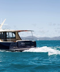 qualia resort boating experience with the wake of a boat across the bright blue Whitsundays waters