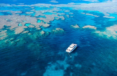 Aerial view of snorkelling and diving boat in Great Barrier Reef as part of qualia resort experience