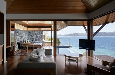 View of private deck with plunge pool and the Whitsundays from inside Windward Pavilion lounge