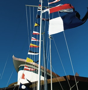 Sailboat with flags in front of Hamilton Island Yacht Club