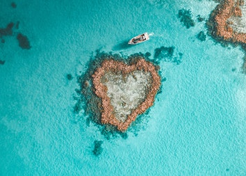 Aerial view of Heart Island in Heart Reef and a boat in the Great Barrier Reef