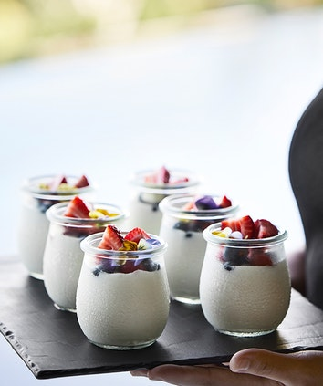 qualia Long Pavilion breakfast service with tray of berry yoghurt glasses