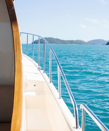 View of Whitsundays waters from the side of the boat used for qualia sunset cruise boating experience