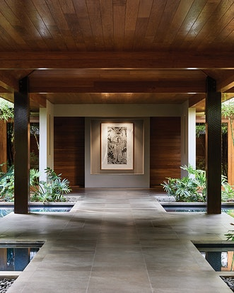 Spa qualia entrance gardens with two pillars and centered mounted wall painting