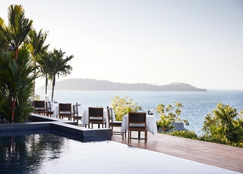 Whitsunday view from dinner tables set outdoor at qualia resort's Long Pavilion restaurant