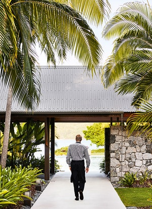 qualia resort Pebble Beach restaurant waiter walking through garden path in the Whitsundays