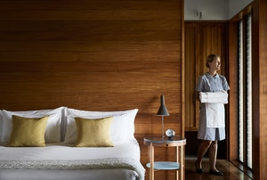 qualia resort housekeeping female staff carrying towels at Leeward Pavilion bedroom