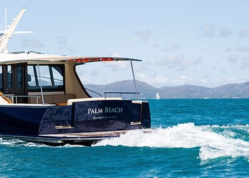 qualia resort experience of luxury motor boat named Palm Beach making waves in the Whitsundays water