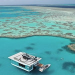 qualia experience of Journey to the Heart featuring luxury pontoon near Heart Island in Great Barrier Reef