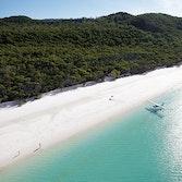 View of luxury sea plane landing on waters as part of qualia's Whitehaven Beach Tour