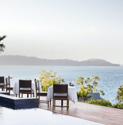 qualia Resort Outdoor Dinner Tables at Long Pavilion Restaurant with Whitsundays Views