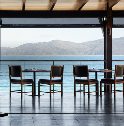 qualia Pebble Beach Restaurant Tables Set For Lunch With Whitsundays Views