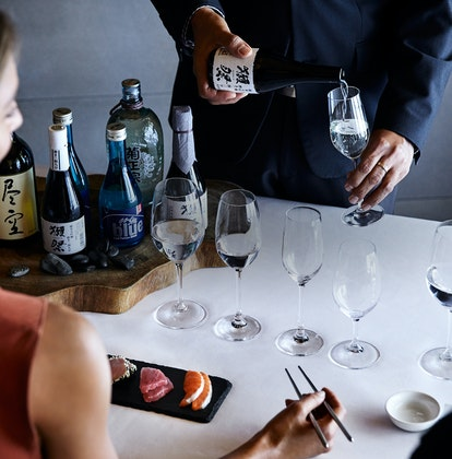 Qualia Resort Talk and Taste Experience with man and woman enjoying sushi and sake tasting