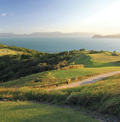 qualia View across Hamilton Island Golf Course with sunlight pouring across from neighbouring Whitsunday island
