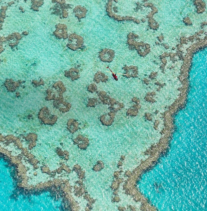 qualia aerial view of turquoise waters in Great Barrier Reef from helicopter scenic flight