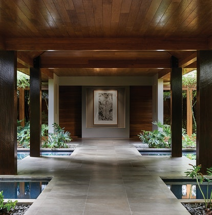 Spa qualia sheltered entrance with four pillars, garden and water features