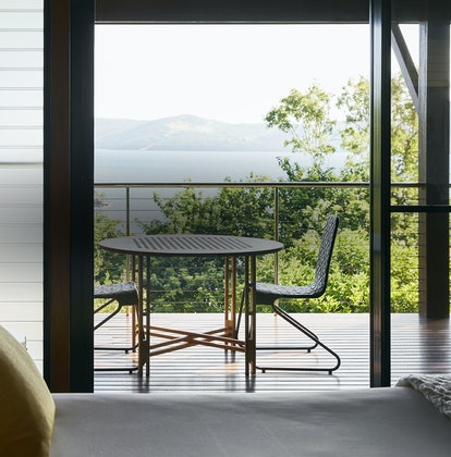 View from Leeward Pavilion bedroom of private furnished deck and ocean view of Whitsundays