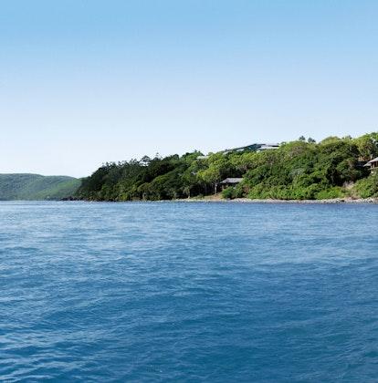 View of destination from ocean in front of qualia resort on Hamilton Island coastline